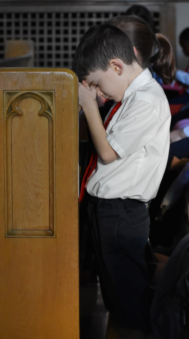 A student taking part in mass